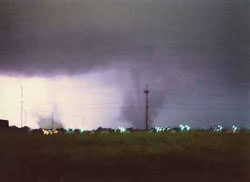 This is the only known photo printed of the tornadoes. The sky was illuminated by lightning, allowing Rod Gartner to get the picture looking north from North Johnson Drive. The apartments at far left at near Faidley and Webb roads. The tornado in the center, and a sister twister at left, were ripping through north-central Grand Island.